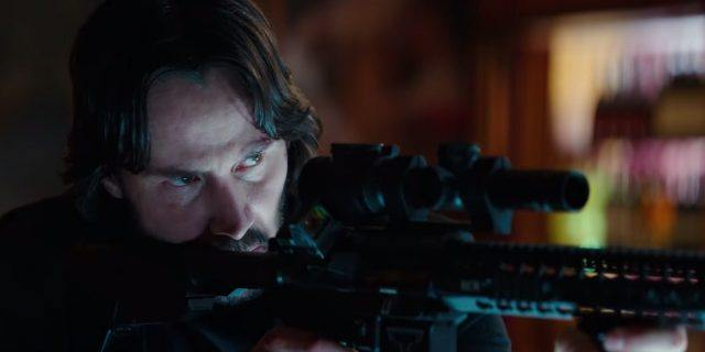 John Wick carefully aiming a firearm.