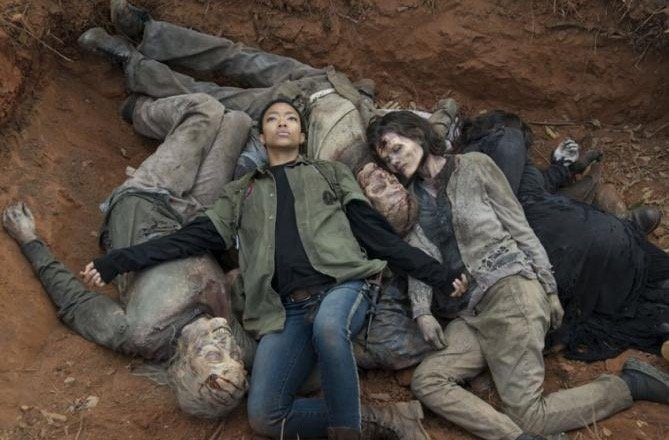 Sasha lying in a pile of dead bodies on The Walking Dead