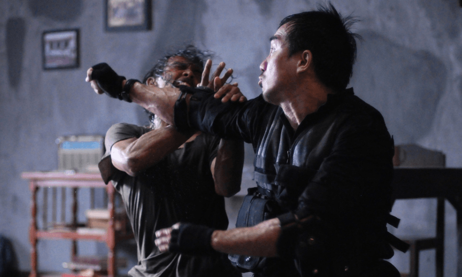 A man throws a fist at an assailant, who flies back