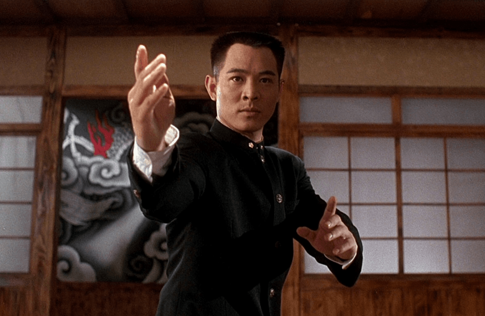 Jet Li with his hand extended out, preparing to fight