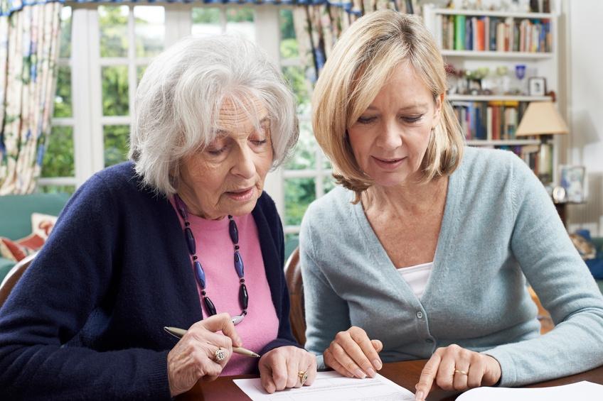 woman helping senior