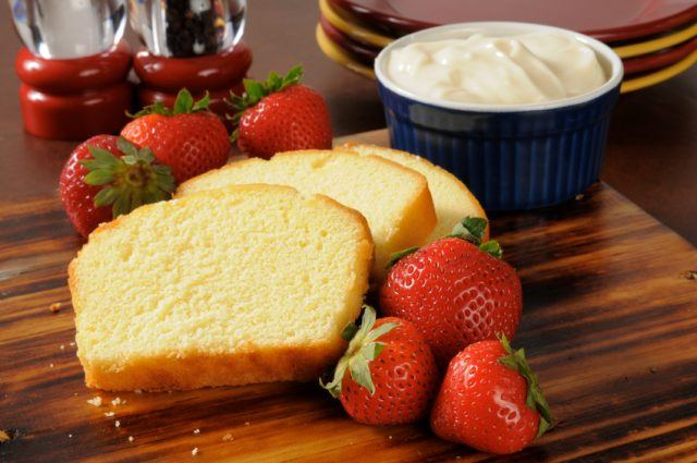 Sliced pound cake, fresh strawberries and whipped cream