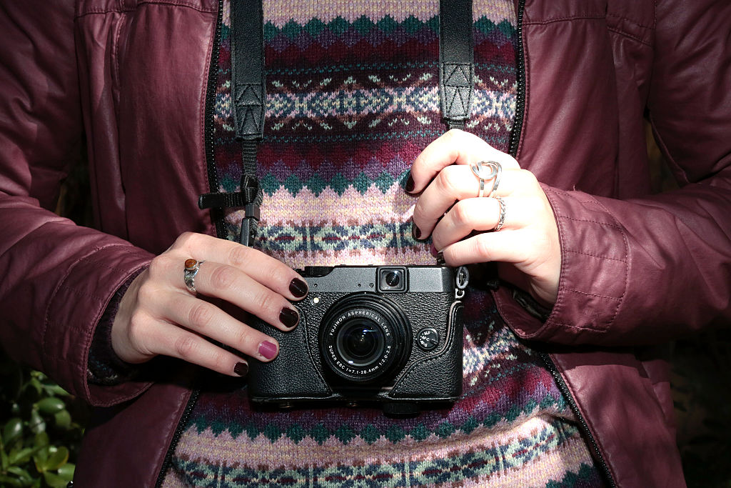 Marta is wearing a Gerry jacket Fujifilm digital camera at the Palo Alto Market
