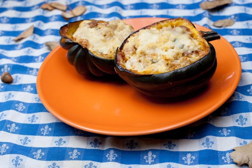 Stuffed acorn squash on an orange plate