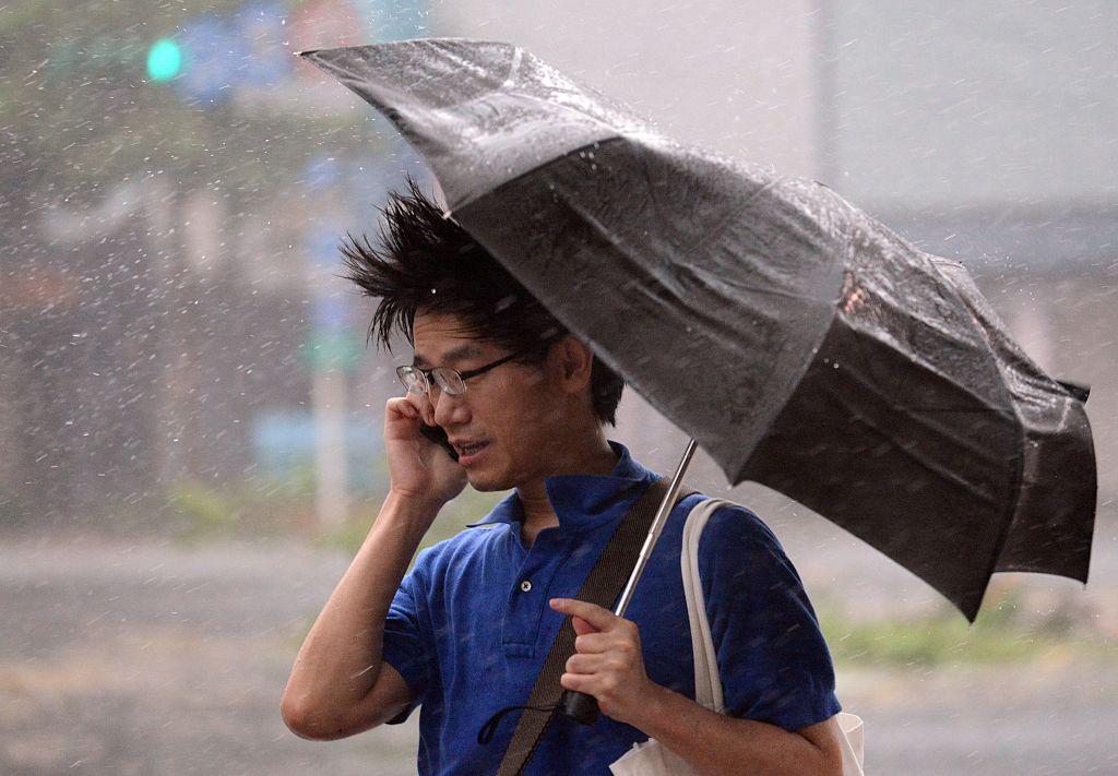 A man speaks on the phone as typhoon Soudelor hits Taipei