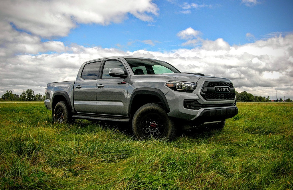 Gray Toyota Tacoma TRD Pro in a grassy field.