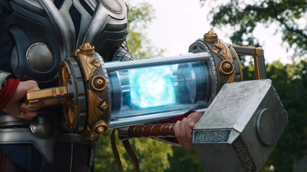 Thor holding the Tesseract in a glowing blue case