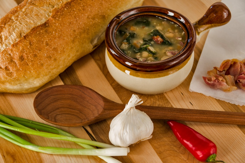 A crock full of hot spicy Tuscan white bean soup
