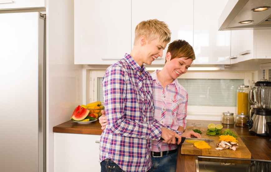 a couple makes a dinner in the kitchen
