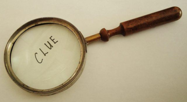 """Magnifying Glass magnifies the word """"Clue"""""""