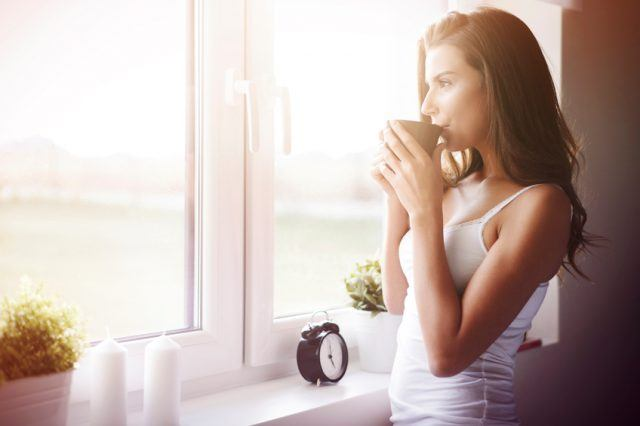 Young woman drinking coffee in the morning