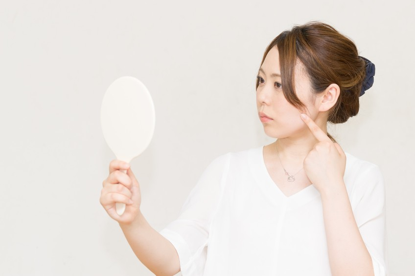 Woman looking in the mirror