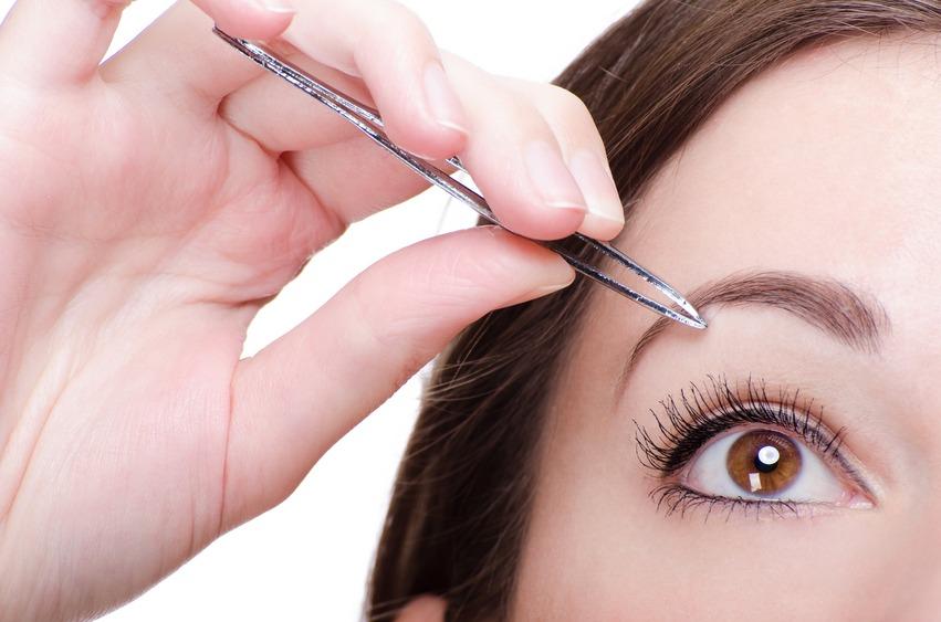 Woman Tweezing Her Eyebrows
