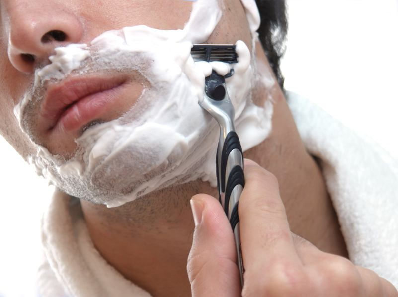 close up of man shaving