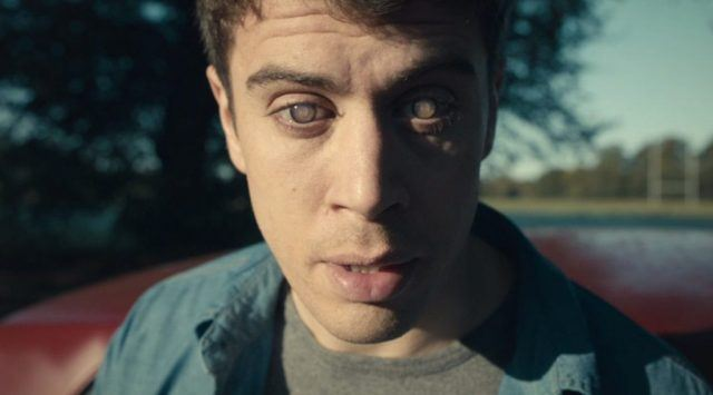 """Liam (Toby Kebbell) stops to watch a memory in a scene from 'Black Mirror's """"The Entire History of You"""""""