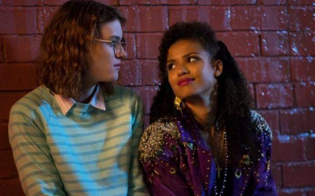 """Yorkie (Mackenzie Davis) and Kelly (Gugu Mbatha-Raw) share a moment in a scene from the 'Black Mirror' episode """"San Junipero"""""""