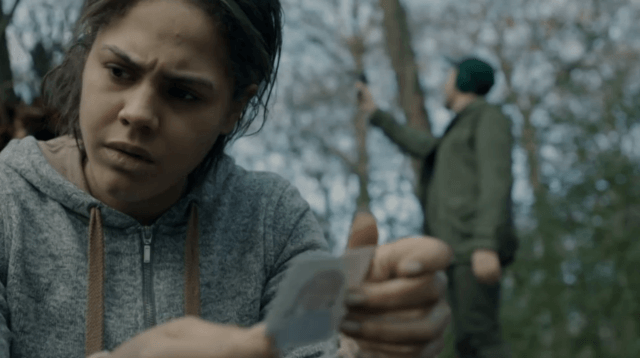 """Victoria (Lenora Critchlow) examines a photo in a scene from 'Black Mirror's """"White Bear"""""""