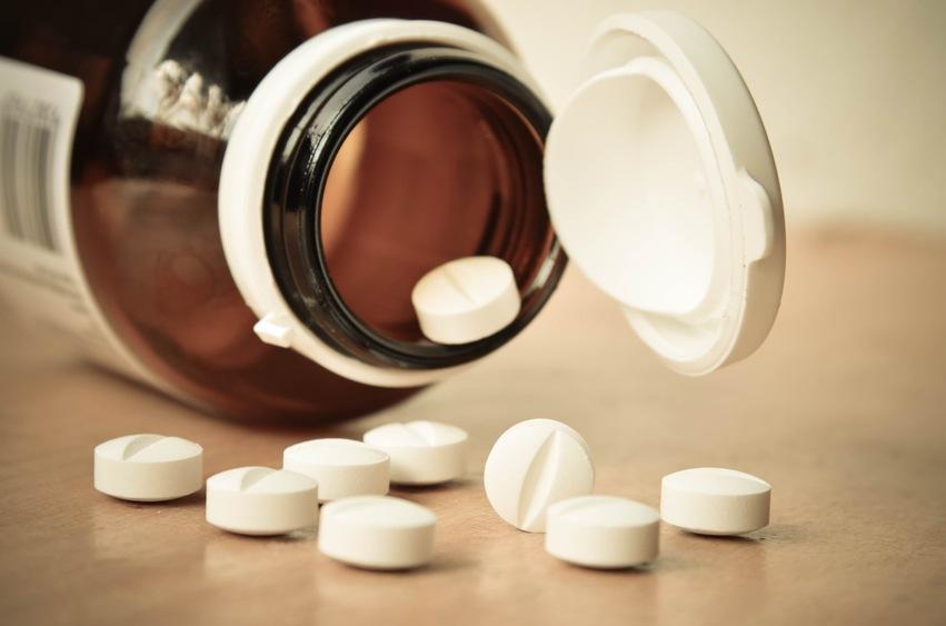 Glass prescription bottle with pills