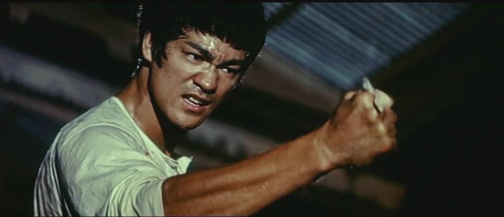 Bruce Lee with his fist extended out, clenched