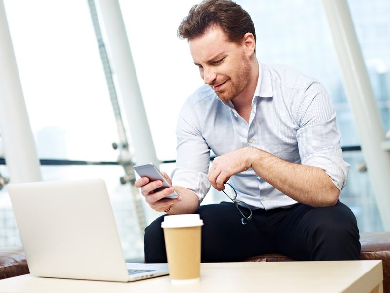 business man reading on his mobile phone