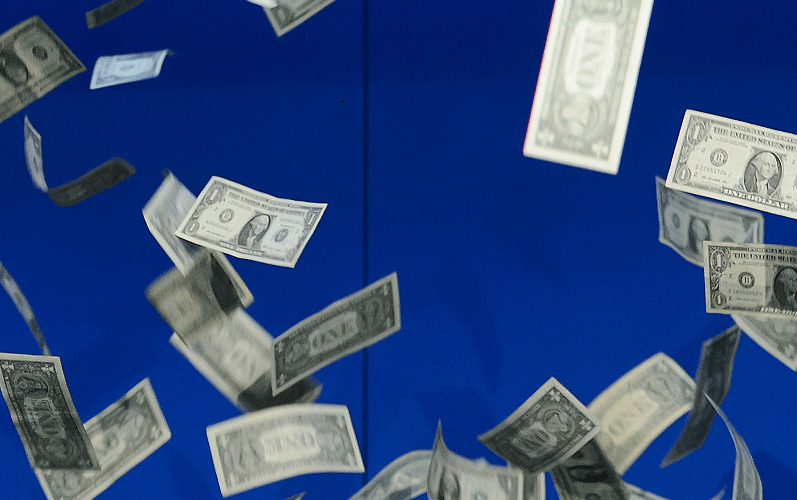 Dollar bills rain from the sky