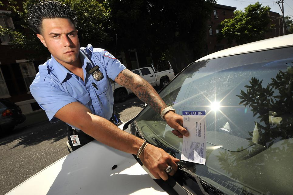 A member of the Parking Wars cast and parking enforcement officer