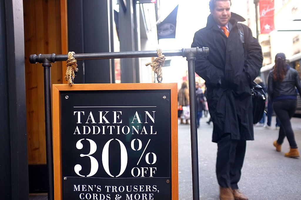 Markdowns are advertised at a discount clothing store