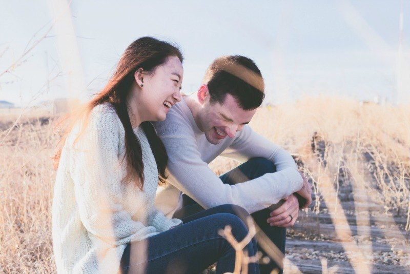 couple laughing outside