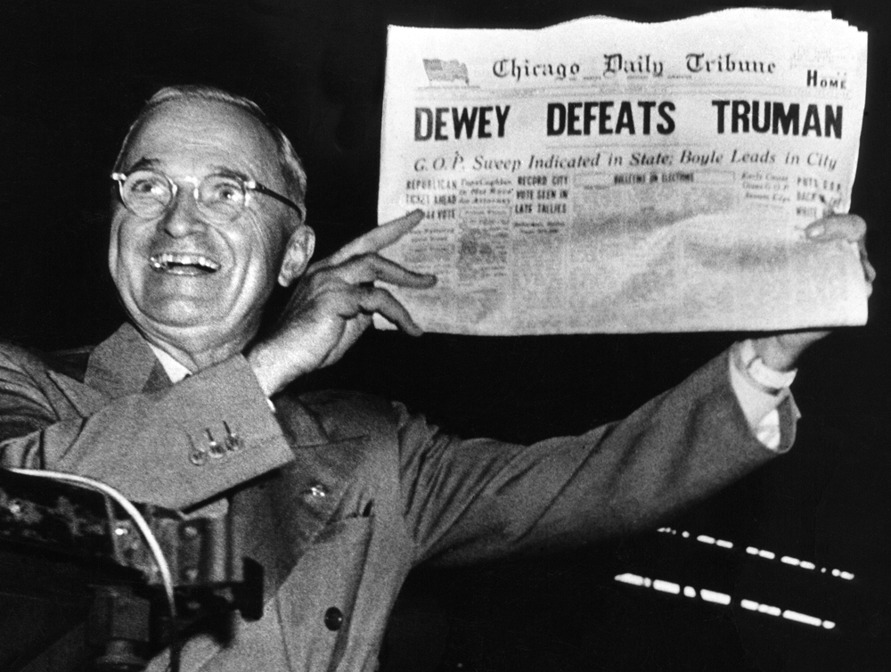 Truman holding an article titled 'Dewey Defeats Truman'