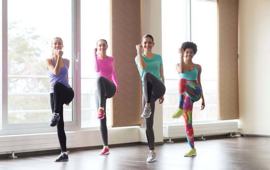 group of happy women working out