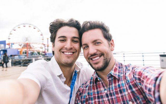 A couple in love in Santa Monica, California taking a selfie