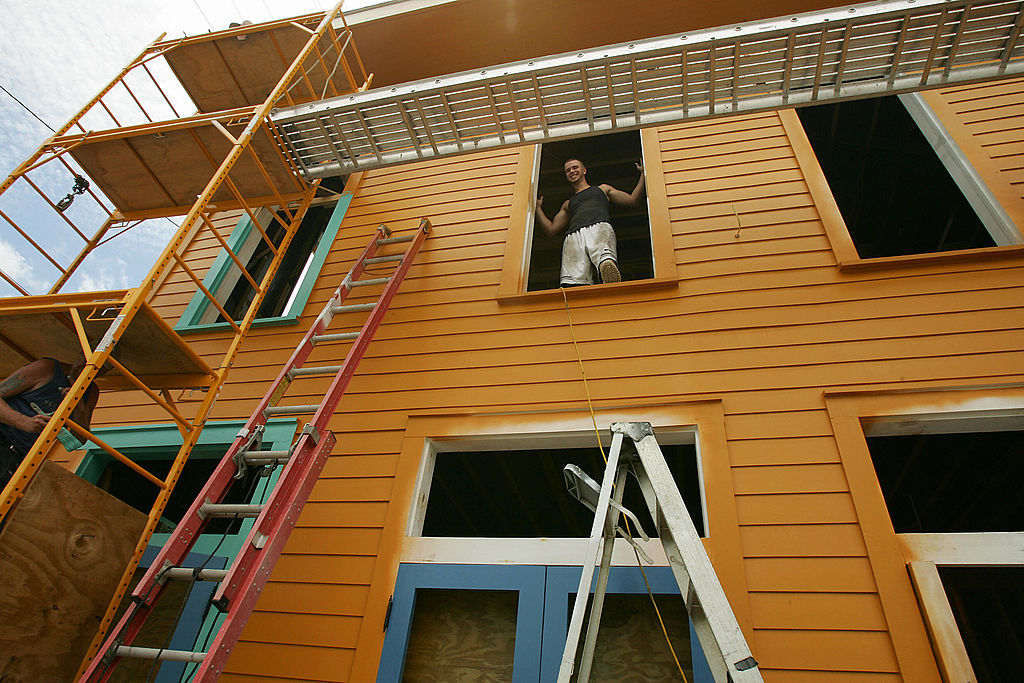 A construction worker repairs a home.