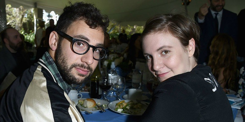 Lena Dunham and Jack Antonoff sitting at a table together.