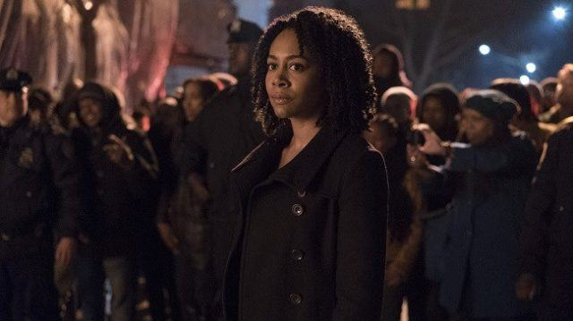 Misty Knight standing in front of a large crowd.