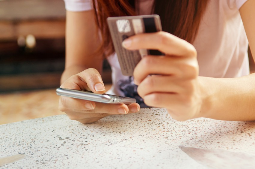 Woman is making online shopping with mobile