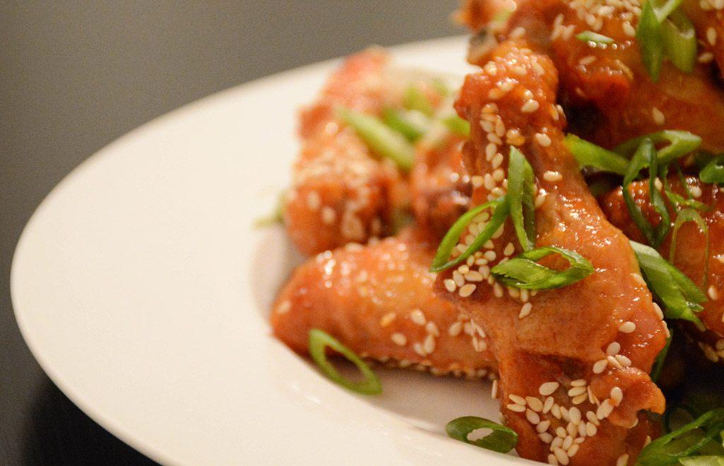 close-up of orange-sesame chicken wings