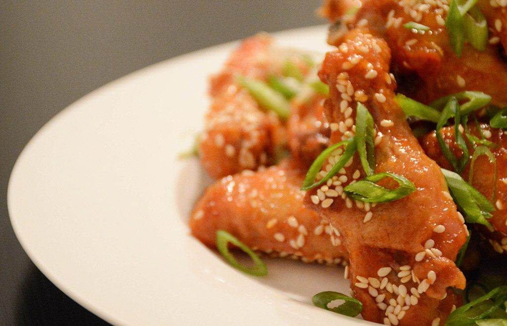 close-up of orange-sesame chicken wings