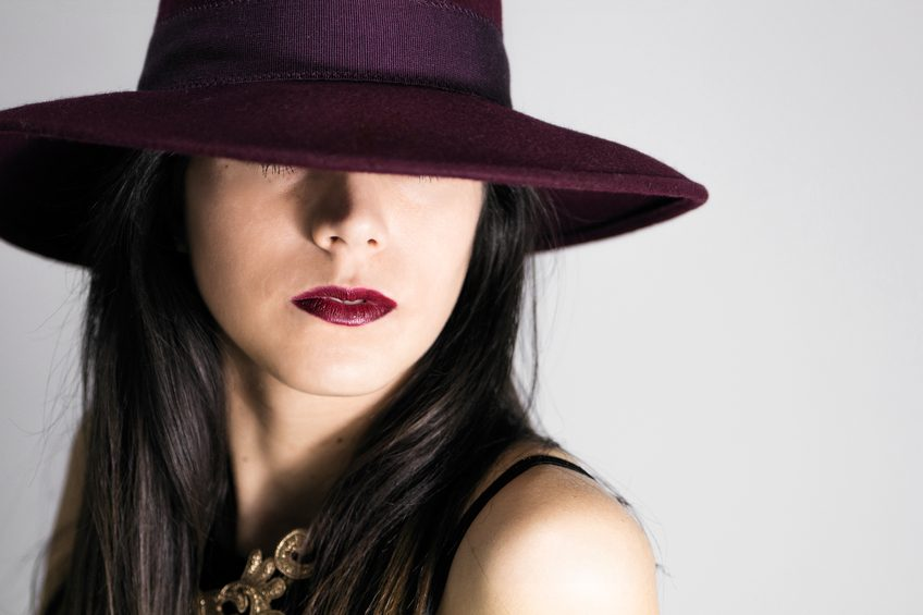 beautiful glamour woman with burgundy hat