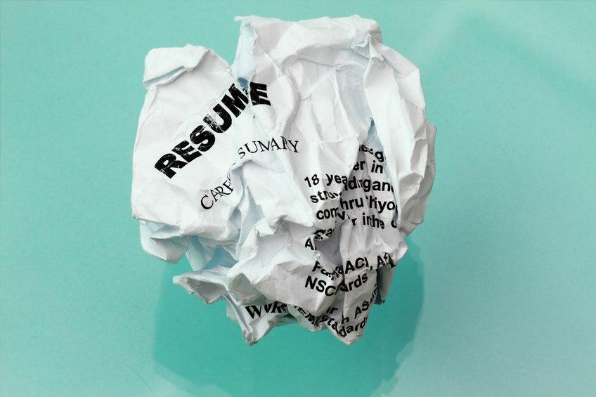 resume crumpled on cyan background