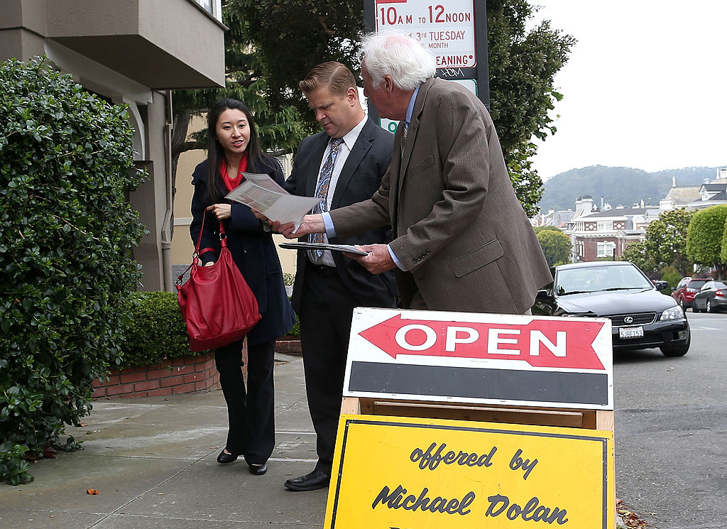 couple hoping to buy a home attend an open house