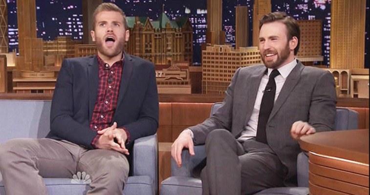 Chris and Scott Evans are sitting next to each other on The Tonight Show.