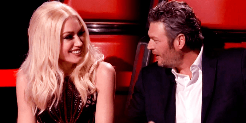 Gwen Stefani and Blake Shelton looking at each other on The Voice.