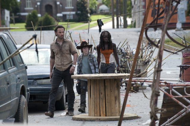"Rick Grimes (Andrew Lincoln), Carl Grimes (Chandler Riggs) and Michonne (Danai Gurira) encounter Morgan's traps in 'The Walking Dead' episode ""Clear."""