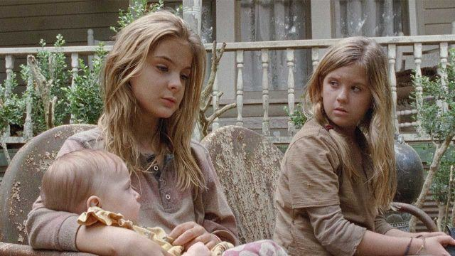 "Lizzie (Brighton Shorbino) and Mika (Kyla Kennedy) sit with Judith in a scene from 'The Walking Dead' episode ""The Grove"""