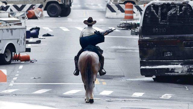 Rick Grimes (Andrew Lincoln) rides his horse through an abandoned Atlanta in a scene from Season 1 of 'The Walking Dead'