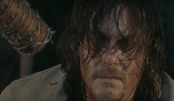 Daryl (Norman Reedus) stares at Negan's baseball bat in a scene from 'The Walking Dead'