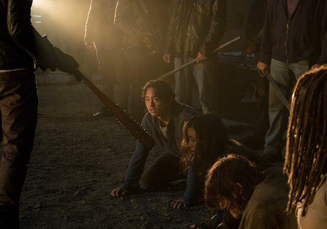 Negan holds Lucille as Glenn, Rosita, Daryl and Michonne cower in front of the Saviors in the seventh season premiere of 'The Walking Dead.'