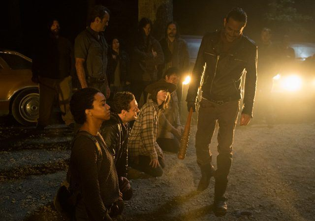 Sasha, Aaron, Carl and Eugene cower before a grinning Negan in a scene from the Season 7 premiere of 'The Walking Dead'