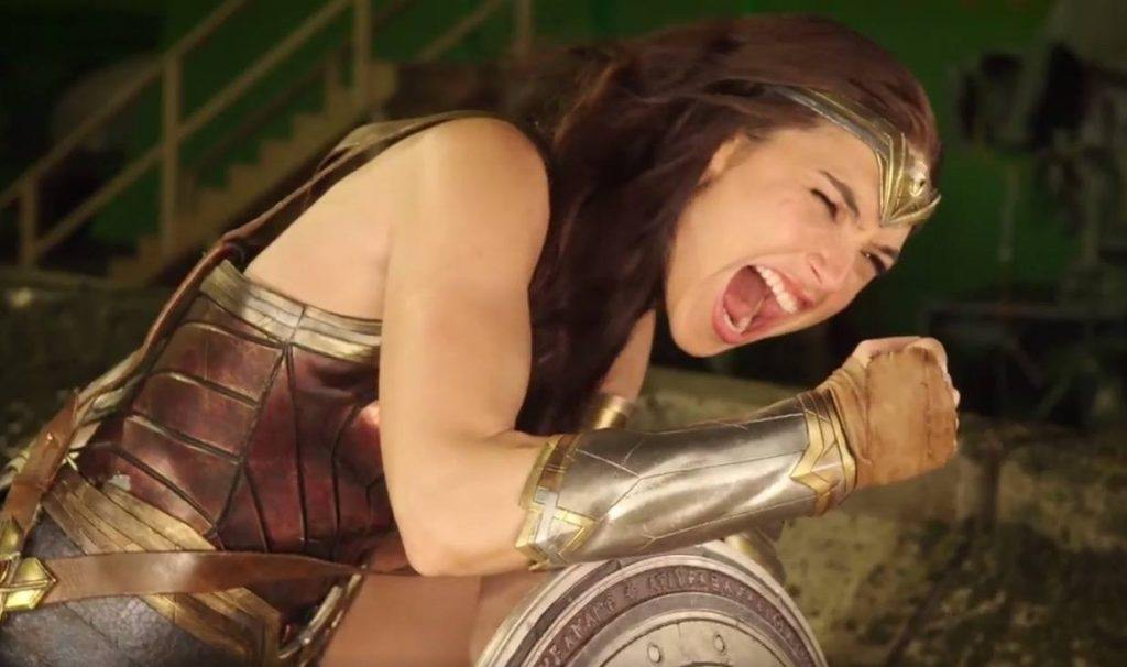 Wonder Woman (Gal Gadot) flexes her arm in a scene from the movie