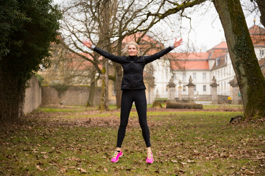 woman doing jumping jack exercises